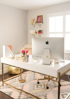 white and gold desk with feminine desk accessories in a white glam home office with patterned rug #luxuryoffice