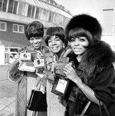 The Supremes with their Polaroid Land Cameras.