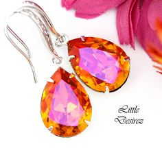FREE US SHIPPING on all orders! Orange Pink Earrings Fuchsia Orange Earrings Swarovski Crystal Astral Pink Earrings Bridesmaid Earrings Bridal Earring Sparkly Earring AP31H  Elegant, unique and brilliant Astral Pink Swarovski Teardrop Earrings! Celebrating happiness and joy, Astral Pink crystal is a bold combination of warm pink and red hues that flash hints of fuchsia and orange. It has an exotic and uplifting appeal, reminiscent of the bright, bold hues of a bustling market in India.
