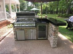 Brick L-Shaped Outdoor Kitchen With Bar Counter Sitting Area