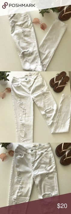High Waisted Ripped Jeans!! High waisted ripped white skinny Jeans. There's a large hole on the left leg over the knee abs rips going down both legs. They're a very comfortable light material! Vibrant M.i.u Jeans Skinny