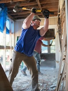 Jason Cameron wastes no time as he smashes through the dining room wall with Chris Grundy at 2014 Blog Cabin.