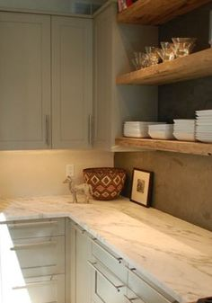 Natural wood open shelving, cement backsplash. It's the contrasts and natural materials that make it.