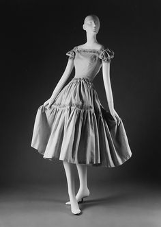 Dress  House of Dior (French, founded 1947)  Designer: Christian Dior (French, Granville 1905–1957 Montecatini) Secondary Line: Christian Dior, Colifichets Date: spring/summer 1951 Culture: French Medium: cotton.  Credit Line: Gift of Mrs. Henry Rogers Benjamin, 1965.  I love the puffy sleeves and the neckline!!!