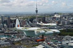 Restored DH Mosquito on it's maiden flight over Auckland city New Zealand, January 2013, accompanied by a Warbird's DH Vampire.