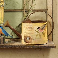 Find an old watering can and modge-podge a picture on it.