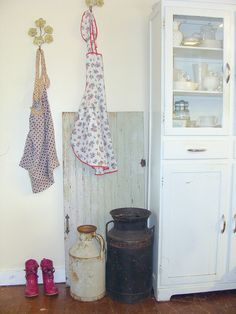 aprons and antiques. Look at those precious aprons hanging on the wall. My sweet, darlin great grandma hung her aprons on the wall like this. This is certainly a country kitchen and I love it <3