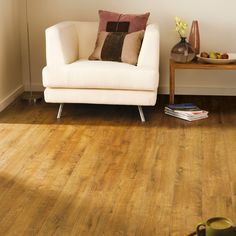 This laminate flooring has an attractive Kolberg oak effect finish and 4 sided bevelled edge. Each plank uses a simple click system, so installation is simple and it's suitable for warm water underfloor heating systems under 28 degrees. Solid Wood Flooring, Wood Laminate, Kitchen Flooring, Water Underfloor Heating, Beige Sofa, Carpet Installation, Floor Colors, Wide Plank