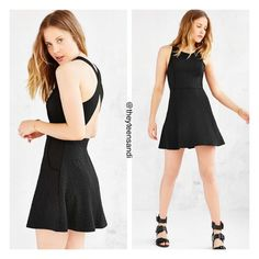 Urban Outfitters Black Cross-Back Textured Dress Soft + stretchy mini dress from fashion-forward Urban Outfitters brand Silence + Noise in a swingy pull-on silhouette. Textured knit featuring thick shoulder straps that cross at the back finished with side-entry front pockets and a breezy open back. Urban Outfitters Dresses Mini