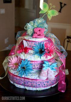 How To Make a Diaper Cake and if you scroll down, they also give you ideas of drinks, appetizers and desserts to serve at a baby shower!