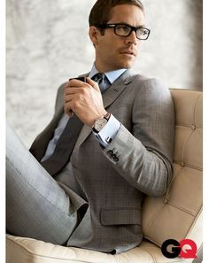 Wool suit by Gucci. Shirt by Paul Stuart. Tie by Louis Vuitton. Glasses by Persol. Cuff links by Cartier. Watch by Hamilton.