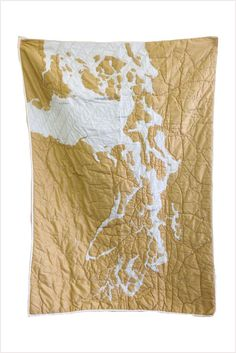 The Puget Sound Quilt isdensely detailed, depicting one of the most complex estuary systems in the world. The quilt covers...