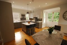 Quality Kitchens, Bedrooms and Living Spaces from a family run business in Guildford, Surrey Two Tone Kitchen, Quality Kitchens, Kitchen Modern, Wood Floor, Interior Design Kitchen, Ground Floor, Wall Tiles, Dark Grey, Living Spaces