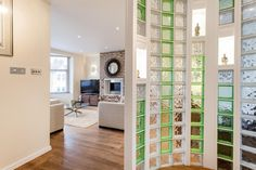 awesome interior glass block partition decoration with solar mirror above fireplace in living room Glass Partition Wall, Living Room Partition Design, Room Partition Designs, Casa Milano, Stairs In Kitchen, Divider Design, Divider Ideas, Glass Brick, Glass Walls