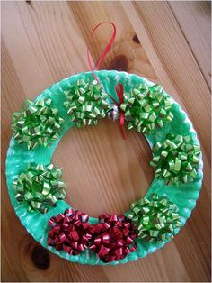 Thought of putting my own spin on this, using last years decorative name tags around the 'wreath' instead of bows.