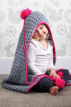 "Based on a large granny square, the ""Granny Gives Back"" crochet hooded baby blanket pattern makes an easy and inexpensive project to donate to children's charities. The oversized hood and playful tassels will give any kid a safe, warm place to escape to. Click for the free pattern using Lion Brand Pound of Love yarn!"