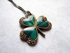 I want.   Vintage Style Shamrock Necklace Lucky Charm St by smallbluethings, $28.00