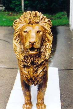 Hand carved lion sculpture by M.J.Y.