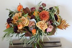 Fall bridal bouquet in autumn colors with garden roses, ferns, dahlias and ranunculus.  Tuscan themed wedding. http://studioblush.com