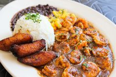 Jamaican Black Pepper Shrimp: Sautéed shrimp with a very spicy Jamaican black pepper sauce for an extra kick! Served with rice, black beans, plantains and cool mango salsa. Available with chicken or chicken and shrimp.