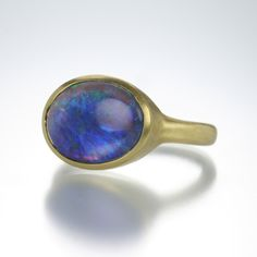 An18k yellow gold ring with an 11mm x14mm black opal center stone. Size 6 3/4. #opalsaustralia