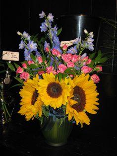 sunflowers, spray roses and delphinium