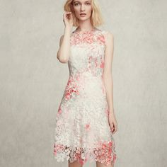 A vibrant floral print enlivens hand-placed floral lace for a casual-couture approach to day dressing.