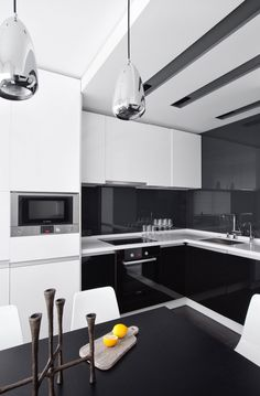 by Design (I would change the white cupboards over the stove to black!)