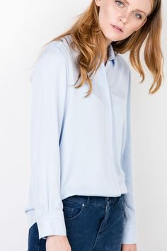 Simply styling with blue shirt and jeans