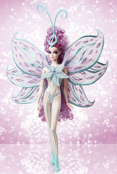 Bob Mackie Princess Stargazer Barbie Doll. This spectacular fairy is adorned in a sheer, glittery bodysuit with a flower at the bodice and embroidered gossamer-like wings. She's perfe...