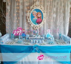 Lovely dessert table with a lighted backdrop at a Frozen birthday party! See more party planning ideas at CatchMyParty.com!