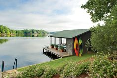 Boat House - Naturally Inspired Georgia Lake House - Southernliving. Down by the water, the boat house is playground central, complete with the kid-favorite diving board.