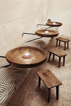 Round rustic leg-less tables, and little stools!