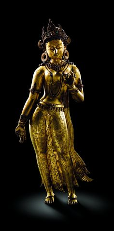 Tara - Female Bodhisattva of Compassion. 13th C. Nepalese, Gilt-copper with inlaid stones.