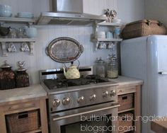 Sweet little kitchen using ikea islands with custom marble tops instead of base cabinets.  Blogger said she left the wheels on so that the cabinets can be pulled out for cleaning.  Beautiful!!  butterfly 8)(8 bungalow
