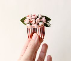 Hey, I found this really awesome Etsy listing at http://www.etsy.com/listing/175060862/sweet-vintage-flower-comb-pink-floral
