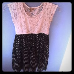 This is a very simple dress size 14 in children's. White lacy up black and silky bottom while polka dots on bottom worn once Speechless Dresses Midi