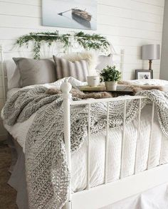 Stunning grey and white farmhouse bedroom - cozy up!