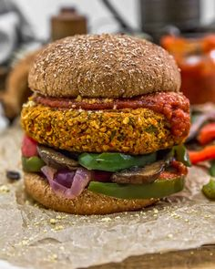 This delicious, wholesome, oil-free Vegan Pizza Burger is brimming with plant-based goodness and aromatic spices the whole family will love. #wholefoodplantbased #vegan #oilfree #glutenfree #plantbased | monkeyandmekitchenadventures.com Pizza Burgers, Vegan Burgers, Savoury Dishes, Vegan Dishes, Vegan Dinner Recipes, Whole Food Recipes, Sauteed Peppers And Onions, Vegan Parmesan Cheese, Great Pizza
