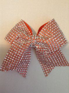 A personal favorite from my Etsy shop https://www.etsy.com/listing/245191440/orange-cheer-bow