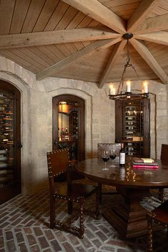 Fantastic wine cellar/room. Reclaimed brick floors, rustic furnishings, stone walls and open beamed ceiling.