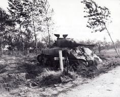 An abandoned American tank and a grave of a soldier after operation Market Garden, 1944