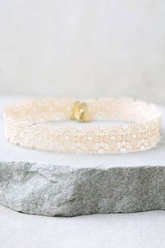 """Do it all in the name of fashion with the For Posh Sake Peach Lace Choker Necklace by your side! The delicate peach lace of this stretchy choker will instantly dress up any outfit. Necklace measures 12"""" around (relaxed), with a 4"""" extender chain."""
