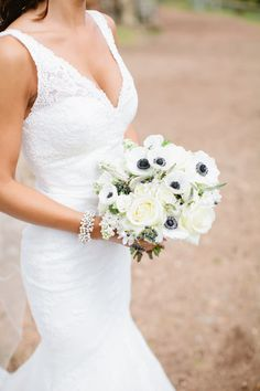 gorgeous lace wedding dress and anemone bouquet