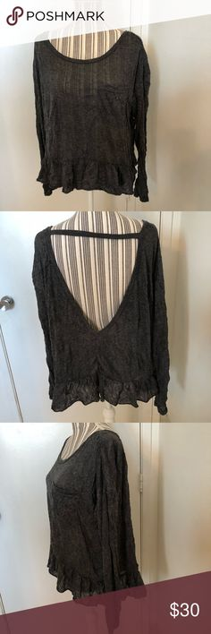 Free People fb beach crinkle lightweight top large Cute and stylish Free People fp beach UO gray crinkle oversized loose fit top . Item still has plastic tag but tag is off . Item has unfinished him and crinkle has small bits of just stress on him edges and nature of material. Open back long sleeve top with strap across back is  meant to be one loose fit . Top is sheer. Daughter said too big . Just tried on few times .Great for festivals or light sweater cover  up for spring . Free People…