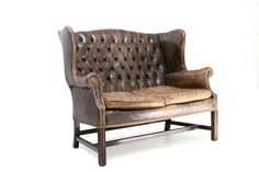 1960s superb buttoned back leather wing sofa, wonderfully aged from Goldwood by Boris on the DC