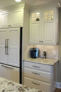 Coffee bar beside fridge/pantry