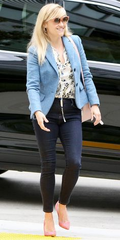 Reese Witherspoon's Sunniest Street Style Looks - March 20, 2017: Sunny as ever, Witherspoon stepped out in Los Angeles wearing a powder blue blazer over a floral print blouse, which she paired with dark-wash jeans, her go-to pale pink tote, matching pumps, and complementary shades.