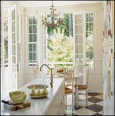 French Country Kitchen - love the French doors leading out to maybe a sunroom or flower garden