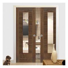 Double Pocket Mistral Walnut sliding door system in three size widths with Clear Glass. #slidingdoors #pocketdoors #pocketdoorpair